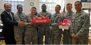 Members of the Mountain View-based California Air National Guard 129th Rescue Wing with Senator Jerry Hill receive 400 valentines made by South San Francisco seniors for Wing members who were recently deployed to Afghanistan and the Horn of Africa. From left, Hill, Captain Jennifer-Ruth Green, Staff Sergeant Jerald See, Airman First Class Tajudeen Mackey-Shittu, Airman First Class Joseph Harris, Airman First Class Raymond Perdue and Senior Airman Jet Crisostomo.