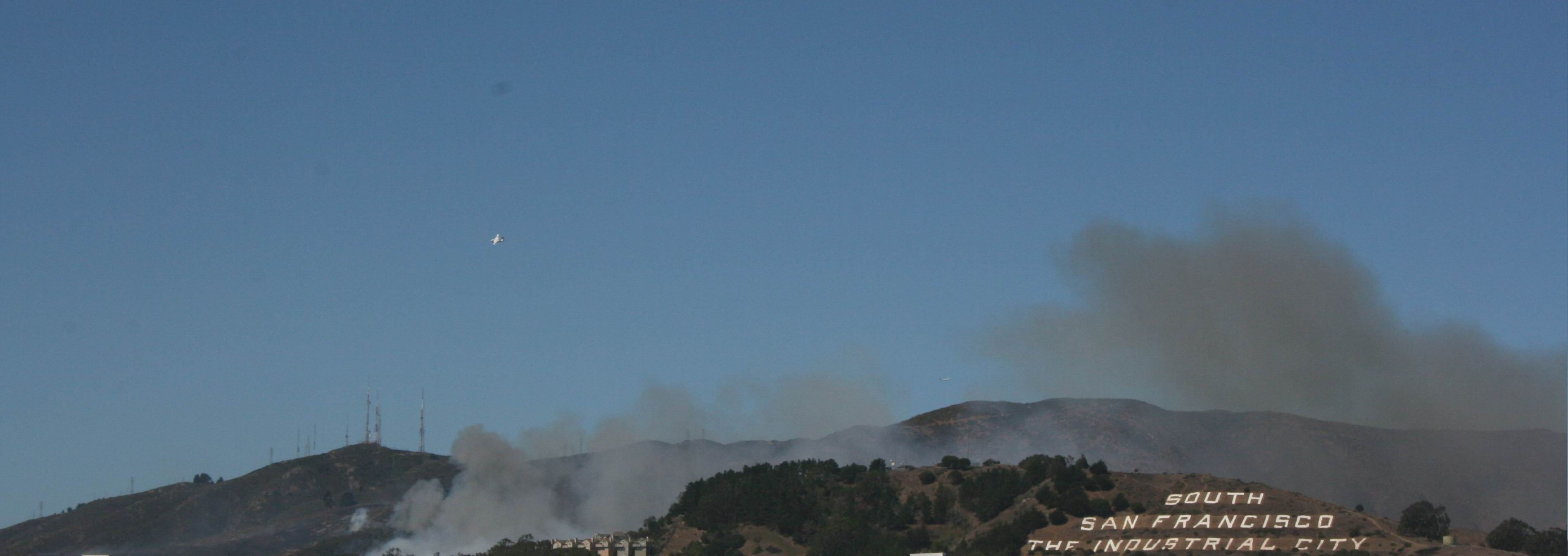 Smoke blows over San Bruno Mountain and through the valley behind Sign Hill Source: cm