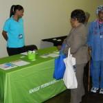 Kaiser representative Leslie Martin interacts with seniors  Photo: KAISER