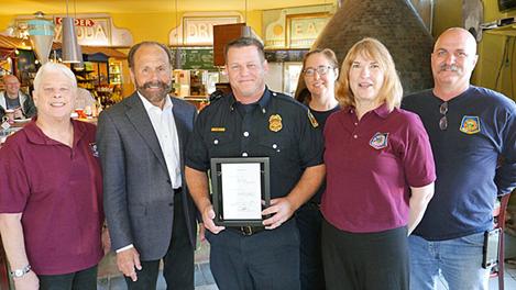 La Honda Fire Brigade Chief Ari Delay and members of the La Honda Fire Brigade board and department receive a framed signed copy of SB 598 at the Pescadero Country Store – November 21, 2015