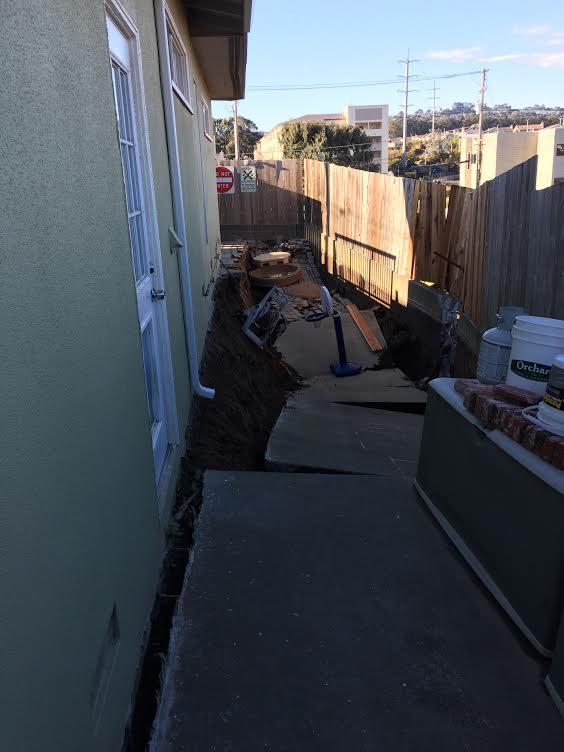 The 20 foot side yard has sunk Photo: Adam Ornellas