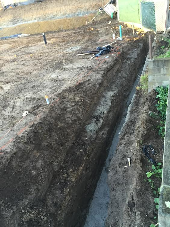 The property boundaries can be seen up against the trench dug by contractors Photo: Adam Ornellas