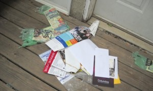 Neighbors are tired of unwanted newspapers and other marketing material left at their homes  Photo credit; redeyechicago