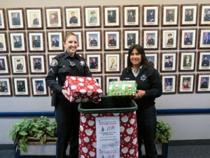 Officer Amy Sariotti & Records Specialist Letty Beard collecting food & toys for local families. Photo: ssf.net