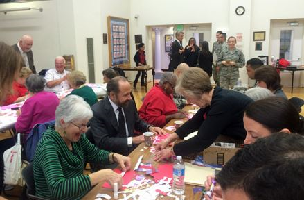 Senator Jerry Hill working with SSF Seniors creating cards for overseas troops