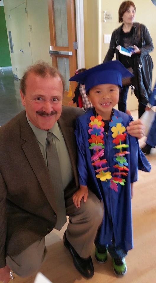 Mayor Mark Addiego with Pre-K student during graduation Photo: Leonard Eng