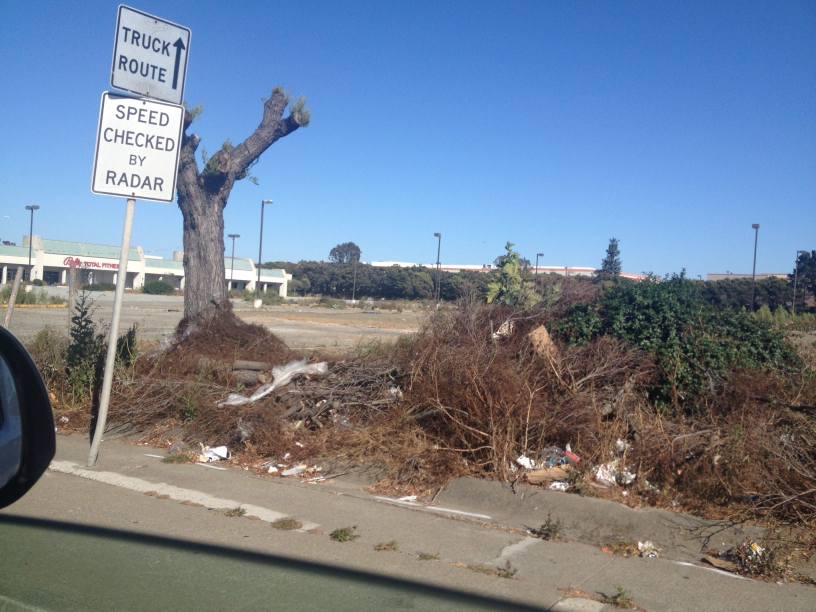 The blight at the corner of El Camino Real/Spruce needs to be resolved