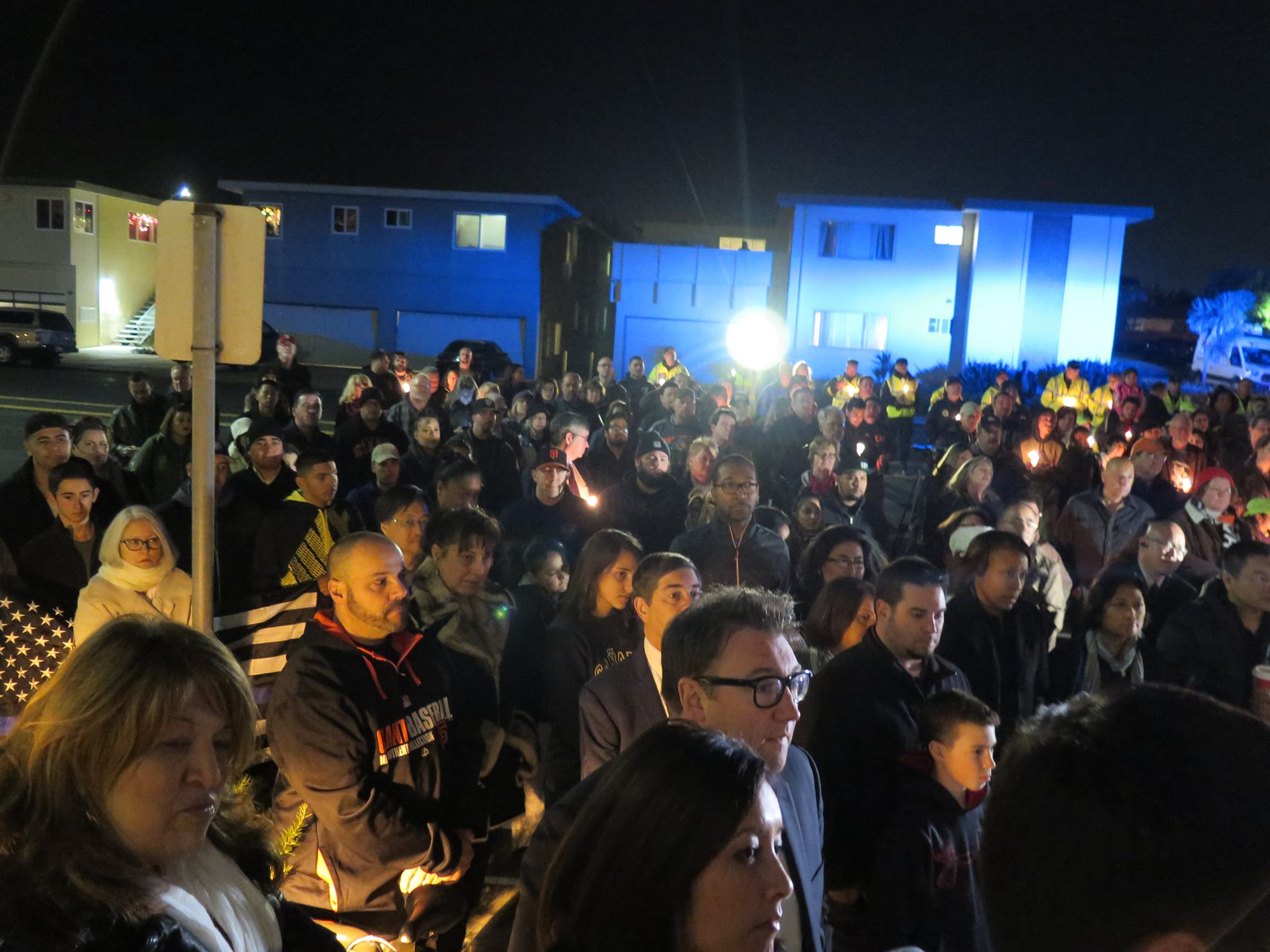 Not knowing the size of the crowd in advance, only 150 candles were available to pass out.<br /> Photo: SSFPD