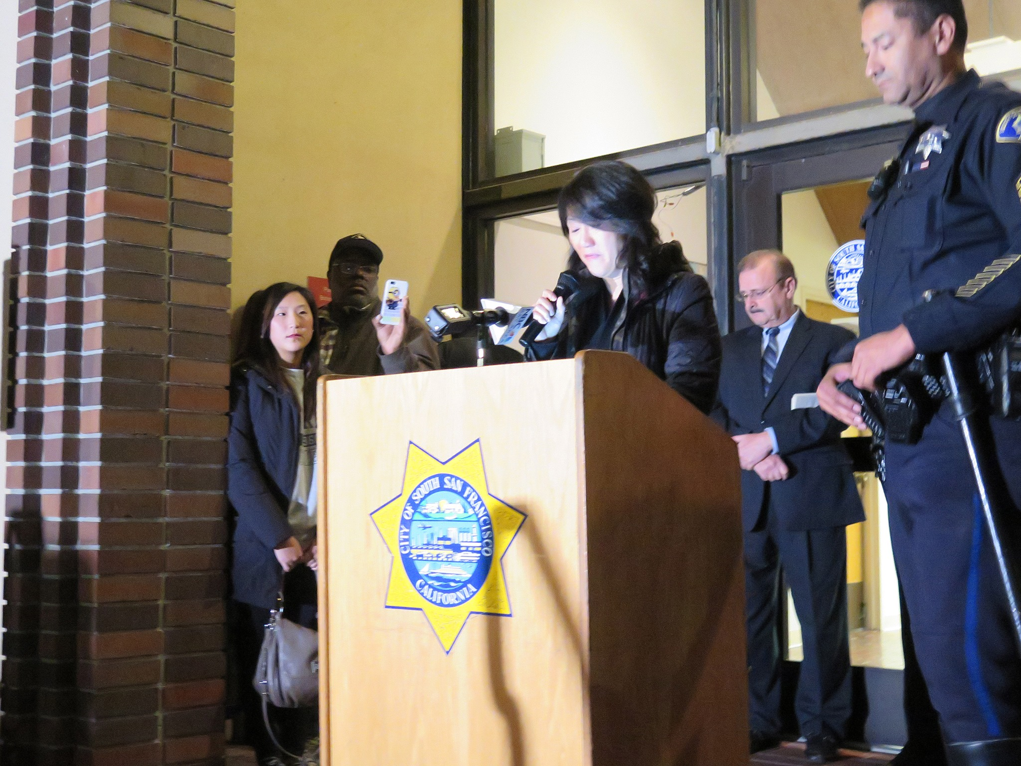"Yumi Chon, Officer Chon's sister, thanked the crowd for their support. ""I beg you to please, please continue to pray for his recovery"" Photo: SSFPD"