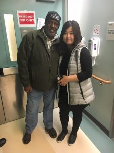Stanley Roberts with Officer Chon's wife at the hospital